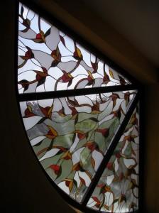 Köriv alakú ólomüveg betét